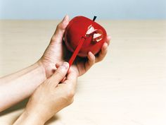 Apple-shaped pencil sharpener by Rabbit Hole, a Japanese design trio comprised of designer Atsushi Suzuki, furniture designer Hidenori Takeuchi and photographer Masakazu Ohnishi.
