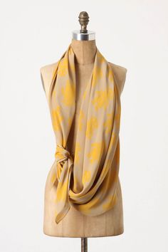 I love the idea of wearing a scarf like this with skinny jeans and a tee