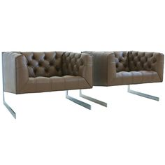 1970's Cantilevered tufted lounge chairs by Milo Baughman