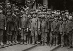 "1910, Coal-mining children. The ""breaker boys"" separated impurities from coal by hand. By Lewis Hine."