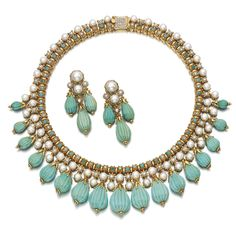 TURQUOISE, CULTURED PEARL AND DIAMOND DEMI-PARURE, 1960S Comprising: a necklace suspending a graduated fringe of fluted turquoise beads, surmounted by cultured pearls and brilliant-cut diamonds, length approximately 405mm; and a pair of ear clips, post and hinged back fittings; each stamped with Italian assay marks.