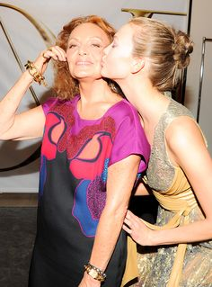 Backstage after the DVF Spring 2014 runway show, Karlie Kloss congratulates Diane on the wrap dress's big birthday! See more: http://on.dvf.com/1KauiZh #FlashbackFriday