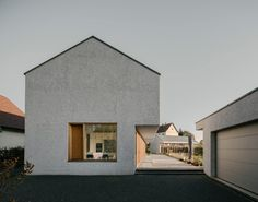 The three parts of the ensemble are made up of a two-storey residential building, an adjoining orangery and a garage/utility unit. The formation marks the transition between the se. Concrete Architecture, Architecture Design, Minimalist Architecture, Brick Cladding, Country House Design, Small Modern Home, Modern Farmhouse Exterior, Small Buildings, Facade House