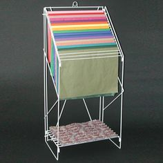 """Tissue dispenser rack-Holds 20 different colors of tissue, has storage shelf for extra reams, card holder attached. 49"""" H x 23"""" W x 15-1/2"""" D, Color white"""