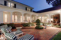 Brick paver patio dominates a back yard