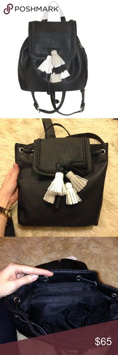 Black Leather Tassel Bucket Bag Backpack Purse Brand new. Braided trim detail, adjustable straps and a faux suede sale. Retails for $78. Length: 10'' width:10'' depth:3.5'' Bags Backpacks