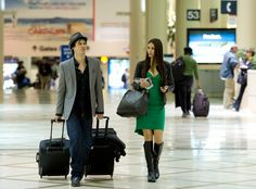 """""""Vampire Diaries"""" stars Ian Joseph Somerhalder and girlfriend Nina Dobrev get ready to depart at Los Angeles International Airport. .Nina is not only strutting the trophy she won tonight in the Favorite TV Drama Actress category at People's Choice Awards she is also wearing the same pretty green dress."""