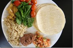 Corn tortillas    Spinach    Tomatoes    Baked tofu    Brown rice    Refried beans    Salsa