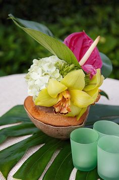"""""""Vibrant Summer Wedding"""" A gorgeous yellow dendrobium orchid is paired with anthurium, crisp white hydrangeas, a monstera leaf and fresh coconut."""