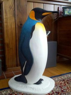 Life size penguin my dad carved out of wood. How do I get this out of his house and into mine?