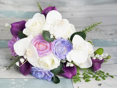 Perfect Cascade Teardrop Bouquet made in a mix of Lavender, Lilac, Violet and Purple tones using Roses, Calla Lilies and Orchids. The perfect blend. A Simple and Elegant Bouquet, perfect for your Purple Theme