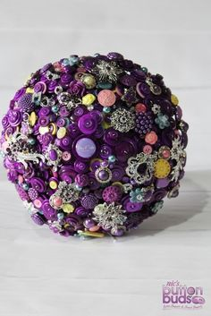 In #love with the #pops of extra #colors in this #buttonbouquet  #alternativebouquet #stunning #buttons #sparkles #alternative #wedding #bride #instaweddings #handmade #love #weddingparty #celebration  #bridesmaids #happiness #unforgettable #forever #ceremony #romance #marriage #weddingday #buttonbouquets #flowers #pearls #australia  www.nicsbuttonbuds.com.au www.facebook.com/nicsbuttonbuds www.pinterest.com/nicsbuttonbuds www.instagram.com/nicsbuttonbuds www.twitter.com/nicsbuttonbuds
