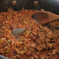 Picadillo VI Recipe Lunch and Snacks, Appetizers, Main Dishes with olive oil, garlic, chopped onion, chopped green bell pepper, lean ground beef, green olives, capers, white vinegar, salt, ground black pepper, ground cinnamon, ground cloves, bay leaves, hot sauce, canned tomatoes