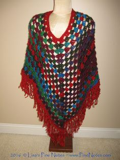 """Cowl neck. Not attached. Still working on pattern. And the #grannysquarestitch #poncho I call """"Harley Quinn"""" Apple Orchard is main #yarn & Trim all around is in Ruby. This is the same yarn as other photos just worked up different. Join me on You tube (link in BIO) on Friday & will explain how I created both cowl and poncho. #fringe #lionbrandyarns #lionbrandyarn #landscapeyarn #crochet #crocheters #festivalfashion #Fall #fallcrocheting #colorwork #color #harleyquinn #granny"""