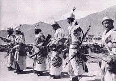 Monlam festival celebration, date and photographer unknown. The Monlam festival celebrates the assumption of dalai lama in cent. Image caption says they are dressed in Mongol uniforms, yellow with red shou longevity symbols. Archery Quiver, Bow Quiver, Archery Hunting, Deer Hunting, Archery Competition, Good Luck Symbols, Kayaking Gear, Traditional Archery, Festival Celebration