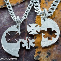These necklaces have the firefighter Maltese cross and a star of life. They are cut from the same coin and interlock perfectly together. They are cut