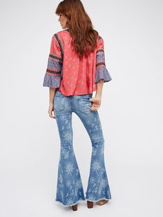 Denim Super Flare   These exaggerated denim flared jeans are American made, and feature a frayed hem and five pocket design. Medium rise zip fly with button closure.