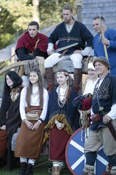 I don't know any of there people, but I've seen some in other photos. These are most likely Latvian reenactors. The two wearing woad in the front row look distinctly Latgallian.