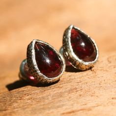 Teardrop cabochon garnet earrings in silver bezel setting with sterling silver post and backing