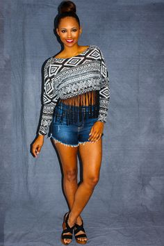 Urbanite Crop Top - Black and white knitted material meets an exaggerated fringe hem creating a staple summer must have piece. Bohemian cool with a urban flair, this cropped thin sweater like crop top is a summer girl's best friend. Stylish and trendy while still being comfy for frolicking around town. Plus it showcases an amazing summer tan! Wear with denim cutoffs for a simple and fun look.  - available online at http://www.envyboutique.us/shop/urbanite/ #Envy #Boutiq