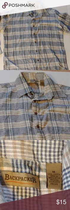 Backpacker orange and blue plaid flannel shirt Backpacker long sleeve button down flannel shirt. rounded hem. blue and orange hem. machine washable. super soft fabric. 100% cotton.   Size medium - 42 chest, 29 length.  See photos for details. Smoke free, pet friendly home.   Please message me with any questions. Ask if additional size detail is needed.   15% discount for 3+ item bundles. Check out my closet. Happy Poshing!  856/CN Backpacker Shirts Casual Button Down Shirts