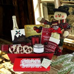 Spread holiday cheer with the fun and delectable Happy Snowman Gift Basket. Filled with rich holiday treats, an adorable sweater-clad snowman, and champagne. Christmas Gift Baskets, Christmas Ribbon, Christmas Sweets, Traditional Christmas Gifts, Yogurt Covered Pretzels, Wooden Wine Crates, Chocolate Peppermint Bark, Chocolate Covered Almonds, Ribbon Candy
