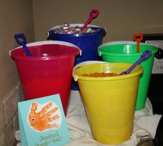 Evis  hand print as a thank you card on dollar store beach buckets filled with dollar store plastic beach toys easy fast and oh so cute