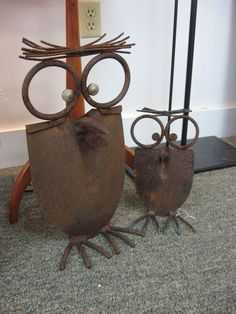 Owls made out of old shovel heads