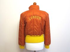Sophia Orange Yellow Puffy Jacket Street Style Winter Outerwear Ski Jacket Hipster Coat Size L Embroidered Letters London by ArtasStore on Etsy https://www.etsy.com/listing/170949611/sophia-orange-yellow-puffy-jacket-street