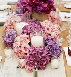 DIY Centerpiece Ideas.  Create a wreath around the candles with high-quality silk wedding flowers from Afloral.com.  Pinned by Afloral.com from http://brideorama.com/new-wedding-decoration-trends/