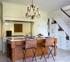 When renovating the cottage, the architects cut new arches through the old walls to create opening up views from the kitchen and entry areas to the garden. Description from nauticalcottageblog.com. I searched for this on bing.com/images