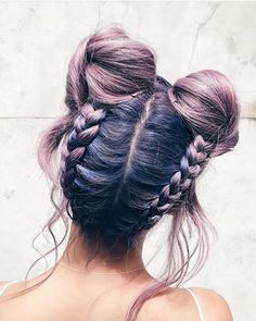 Up-done dutch braids into buns, with cute flyaway strands. This is such a creative hairstyle.