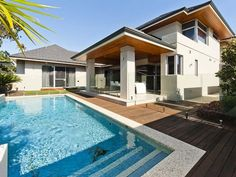 This Inspirational Contemporary Double Storey House with Plan is situated on a manageable corner block of 725.9m2 and has a total built up area of 518sqm including garage, portico and alfresco.