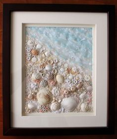 Collection of shells worked into embroidery, with organza ribbon, pearls, & beads.  Very intriguing method.  #textile #art