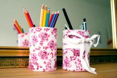 We've made these out of the Republic of Tea canisters, with scrapbook fabric and ribbon. Hannah's are always so cool.