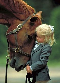 the love and bond between a girl and her horse :) Hopefully one day I will have a picture like this