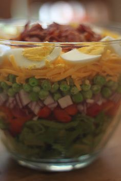 7 layer salad...great for a gathering. lettuce, frozen peas, onion, tomato, cheese, bacon, hard boiled egg, can sub in carrots, or celery- if you don't like another of the ingredients.   AWESOME-easy dressing-1c mayo, 1/4 c sugar, 1 T vinegar