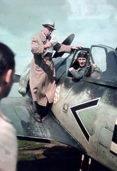 "In September 1942, III.Gruppe / Jagdgeschwader 26 (JG 26) ""Schlageter"" received some special visitors at its base at Wevelghem, Belgium. Profesor Kurt Tank, Focke-Wulf's chief designer, and his senior engineer Rudolf Blaser, chief designer for single-seat fighters and head of the Fw 190 program, came to asses the Gruppenstab's operational experiences with the Fw 190 A-2. The photo shows Oberingenieur Blaser on the wing of a Fw 190 A-2"