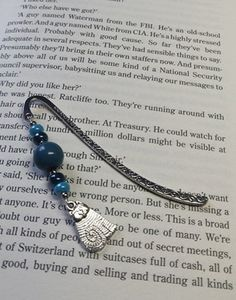 This bookmark is from my Quirky Cat range, lovingly handmade in Northern Ireland. Ive used glass blue and silver tone beads to compliment a Tibetan style marker and finished it off with a quirky Cat charm. The bookmark measures approximately 9 cm and comes presented in an organza bag, making it Organza Bags, Northern Ireland, Blue And Silver, My Images, Bag Making, Markers, My Design, Range, Drop Earrings