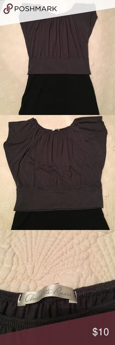Charlotte Russe gray shirt Sexy Charlotte Russe shirt this can be worn with a pair of pants and black boots for a night out.  Or with a black skirt and boots to the office.  This shirt can be worn with anything thing really and you will be a looker in it.   Flowing up top and a wide band at the bottom to show off your waistline. Charlotte Russe Tops Blouses
