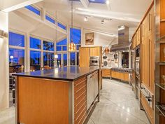 Spectacular kitchen with Canadian walnut cabinets and black granite counters