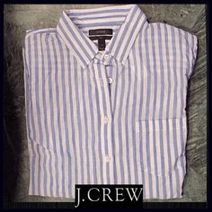 J.CREW Guazy Button-up This boy shirt from J.CREW is made of a lightweight gauzy cotton material, in a blue/white stripe. It is a tunic length, as it is in a size 10tall. I wanted a breezy lightweight button up for spring days, and this definitely had that. It is brand new with tag. J. Crew Tops Button Down Shirts