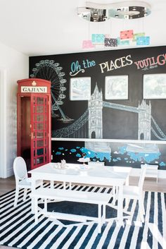 Oh the Places You'll Go Playroom - love the travel + adventure feel in this space with the chalkboard wall drawing and the red telephone booth!