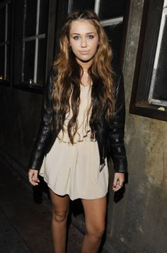 perfection. love the edginess of the jacket with the sweetened of the dress and boho locks.