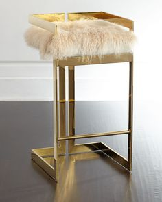 """Handcrafted barstool. Brass-plated iron base. Natural Mongolian (China) fur cushion. Light assembly required. 17""""W x 17.5""""D x 34""""T. Seat, 30""""T; footrest, 9.5""""T. Imported. Boxed weight, approximately 2"""