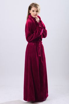 what a nice housecoat, full length and a sensual look. the lady is modeling well. I do miss a pair of slippers