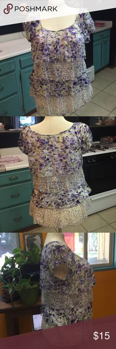 Ruffled Peasant purple flower shirt  Ruffled Peasant Purple Flower shirt. Lined with Shear Ruffled Material a little stretchy. So cool and comfortable goes great with leggings. I cut the tags out so it would not itch. Like new  Bought at Macys Tops Blouses