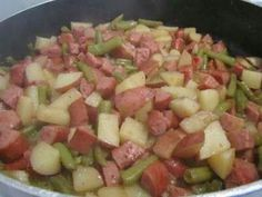 CRACKPOT SLOP - 1Lg can of Green Beans(don't drain), 8 cut up Russet Potatoes, 2 sliced up Kielbasa Sausages, 1 diced up onion - Put in enough water to cover potatoes - Drop in 4 Chicken Bouillon cubes, Salt and pepper to taste - Cook on high for 6hrs. Stir right before serving but not until then!