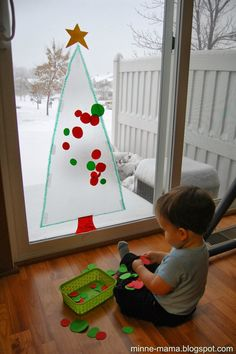 Contact Paper Tree craft for kids- stick & restick . Kids love decorating this tree over & over again!