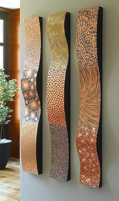 Ribbons Wall Sculpture by Linda Leviton. Modular copper wall sculpture, finished in three distinct patinated patterns. Can be hung horizontally or vertically and in groups. Colors include terra cotta, black, fern green, and waterfall blue. For availability and pricing of custom sizes and color combinations, please contact our Customer Care department. In the box below, please indicate your preference: V (vertical) or H (horizontal).